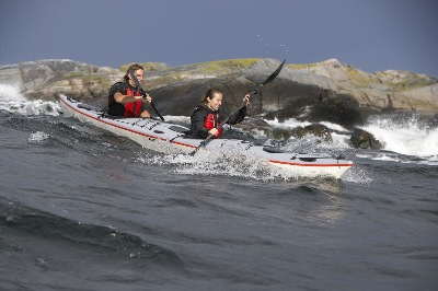 Lina and Paul tackle waves in DoubleShot double kayak